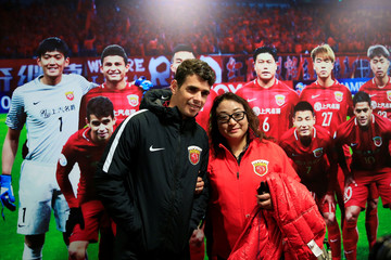 Brazilian soccer player Oscar poses for pictures during the 2017 SIPG Football Club's season mobilization of the Chinese Super League, in Shanghai