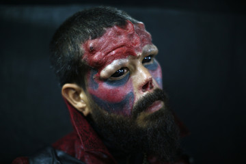 """Body modification artist Henry Rodriguez, also known as """"Red Skull"""", poses for a picture at Caracas's International Tattoo Festival"""