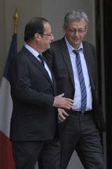French President Hollande speaks with Communist party National Secretary Laurent at the Elysee Palace in Paris