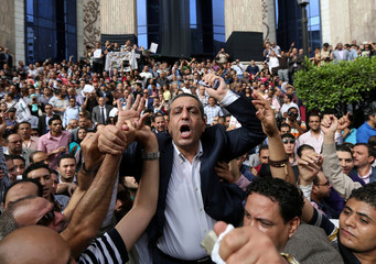 File photo of journalists carrying Kalash, head of the Egyptian press syndicate, during a protest against restrictions on the press and to demand the release of detained journalists, in front of the Egyptian Press Syndicate's headquarters in downtown Cairo