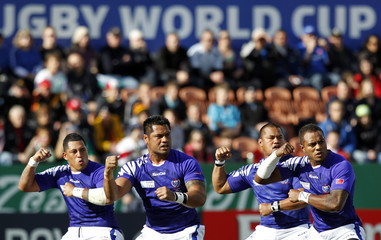 Samoa players perform the Siva Tau before their Rugby World Cup Pool D match against Wales at Waikato Stadium in Hamilton