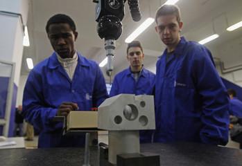 Pupils check quality of product in classroom in Centro de Formacao da Industria Metalurgica e Metalomecanica vocational training center in Lisbon