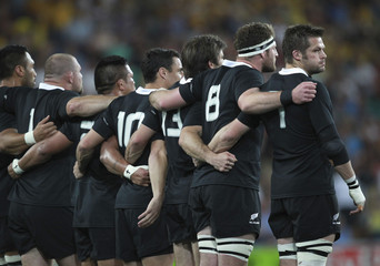 New Zealand All Blacks captain McCaw stands with team mates before their Bledisloe Cup rugby union test match against Australian Wallabies in Brisbane