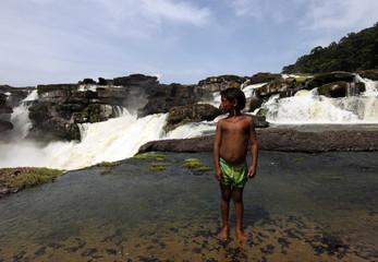 A Kabiyari Indian stands in front of the Raudal de Jirijirimo waterfall in Yaigoje Apaporis National Nature Park