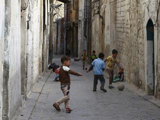 Boys play soccer in Old Aleppo