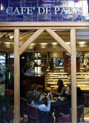 People sit inside Cafe de Paris in downtown Rome