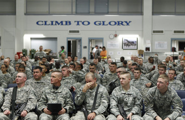 Soldiers from the 10th Mountain Division wait to board a flight to Afghanistan from Fort Drum, New York