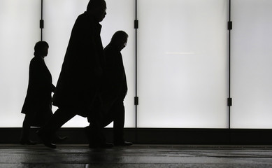 People walk at a business district in Tokyo