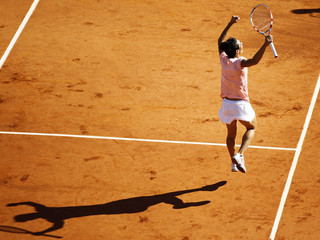 Schiavone of Italy reacts after defeating Bartoli of France during their semi-final match at the French Open tennis tournament at the Roland Garros stadium in Paris