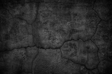 gloomy concrete wall with cracks. destroyed black slab of slab
