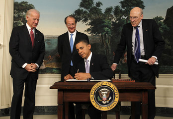 U.S. President Obama signs an executive order at the White House in Washington