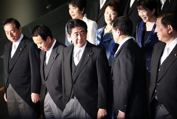 Japan's Prime Minister Shinzo Abe and his cabinet ministers prepare for a photo session at Abe's official residence in Tokyo