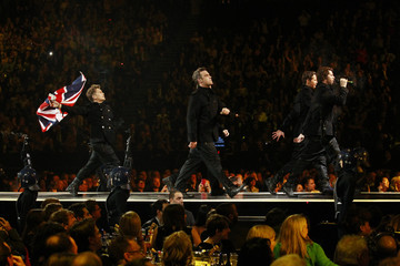 Take That perform during the BRIT music awards at the O2 Arena in London