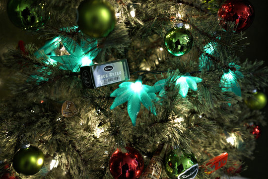 A Christmas tree is decorated with marijuana leaf shaped lights at the Grass Station marijuana shop on Black Friday in Denver