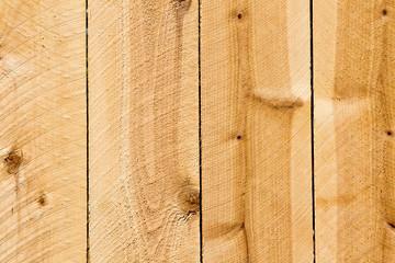 Planks of a new cedar privacy fence