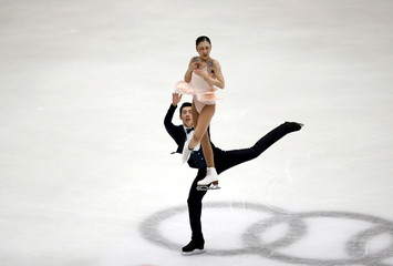 Wang Xuehan and Wang Lei of China compete at the pairs free skating program during China ISU Grand Prix of Figure Skating, in Beijing