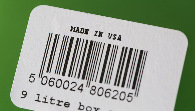 """A barcode label with """"Made In U.S.A."""" written on it is pictured on a plastic tote in San Diego, California"""