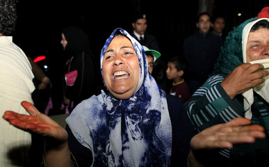 A Libyan woman cries during a protest against air strikes by the coalition in Tripoli