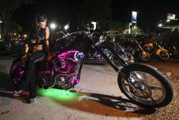 Christina Davie of Christiansburg, Virginia, waits outside the biker bar Suck Bang Blow in Murrells Inlet