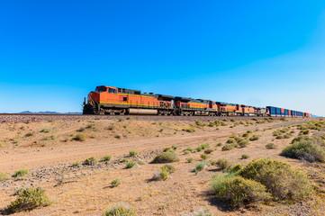Freight Train driving through Mojave Desert , California, USA