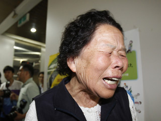 A client of the suspended Busan Savings Bank cries as she leaves after watching a trial for the bank's corruption scandal in Seoul