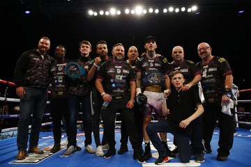 Sam Eggington celebrates with his team after winning the fight