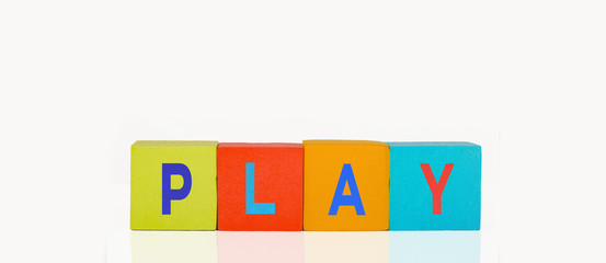 colorful toy building blocks in a line text play