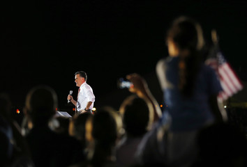 Republican presidential nominee Romney takes the stage at a campaign rally in Fishersville