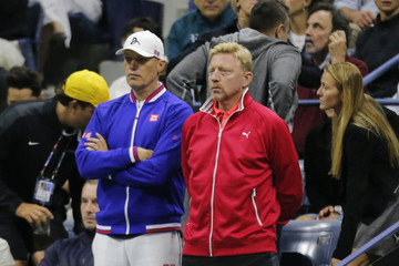 Retired tennis great Becker of Germany watches Djokovic of Serbia play Federer of Switzerland during their men's singles final match at the U.S. Open Championships tennis tournament in New York