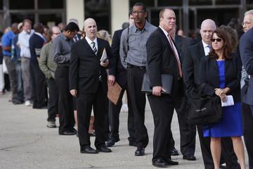 People wait in line to enter the Nassau County Mega Job Fair at Nassau Veterans Memorial Coliseum in Uniondale, New York