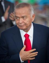 FILE PHOTO -  Uzbekistan's President Islam Karimov greets public during celebrations on the Independence Day in Tashkent