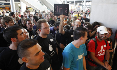 Hundreds of people, some of which waited for 24 hours, line up to enter Apple's first store in Spain, before the doors are opened in Barcelona