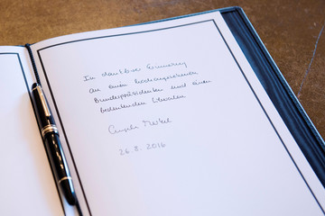 A picture shows the message written in the condolence book for former German President Scheel by German Chancellor Merkel at Bellevue Palace in Berlin