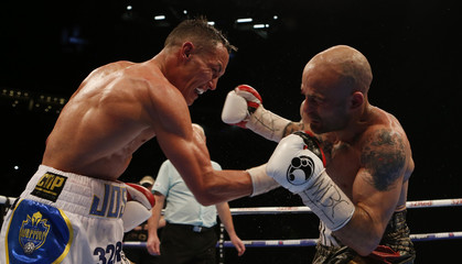 Josh Warrington in action with Kiko Martinez