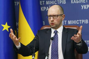Ukrainian Prime Minister Arseny Yatseniuk addresses a news conference in Kiev
