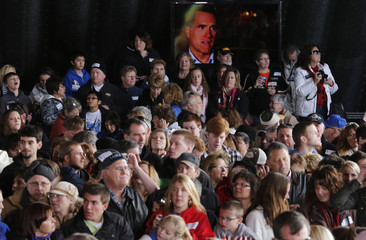 U.S. Republican presidential nominee and former Massachusetts Governor Romney is seen on a television screen at a campaign rally in Dubuque