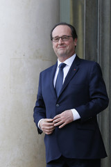 French President Hollande stands on the steps of the Elysee Palace after a meeting in Paris