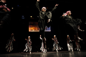 Palestinian dancers of the Al-Quffyiah Group from the Lebanese Ain al-Hilweh Palestinian refugee camp perform at the Royal Culture Center in Amman