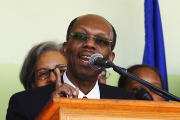 Haiti's former president Jean-Bertrand Aristide speaks during a news conference after his arrival at the international airport in Port-au- Prince