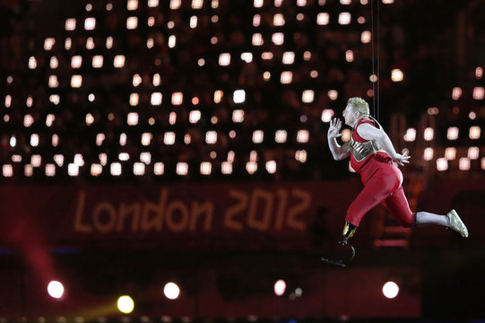 Paralympic athelete is lifted into the air in Olympic Stadium during opening ceremony of London 2012 Paralympic Games