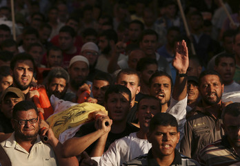 Mourners carry the body of one of four Palestinians from the Juda family, whom medics said were killed in an Israeli air strike, during their funeral in Jabaliya in the northern Gaza Strip