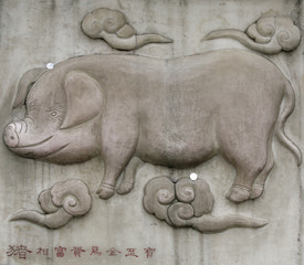 A photo shows a relief of a pig as one of Chinese zodiac signs at the Bai Yun Guan or White Cloud Temple in Beijing