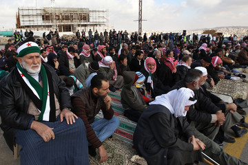 Syrians living in Jordan perform Friday prayers before protesting against President Bashar al-Assad in front of the Syrian Embassy in Amman