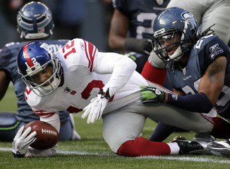 New York Giants wide receiver scores a touchdown against the Seattle Seahawks during the second quarter of their NFL football game in Seattle, Washington