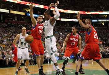 Philadelphia 76ers' Hawes guards Boston Celtics' Rondo as Rondo loses control of the ball during Game 1 of their NBA Eastern Conference semifinal playoff basketball series in Boston