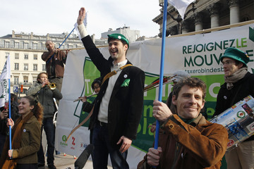 Members of the ecology activist group Robin des Bois stage a protest demonstration for a tax on all financial transactions near the former Paris Bourse ahead of a G20 meeting