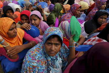 Rohingya migrants women who arrived in Indonesia by boat wait for breakfast inside a temporary compound for refugee at Kuala Cangkoi village in Lhoksukon