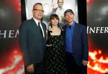 """Director of the movie Howard and cast members Hanks and Jones pose at a special screening of """"Inferno"""" at Directors Guild of America in Los Angeles"""