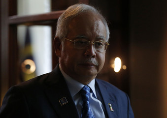 Malaysian Prime Minister Razak arrives to sign the book of condolence at the residence of the Netherlands' ambassador in Kuala Lumpur