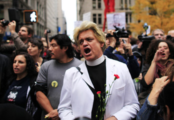 Bill Talen, known as Reverend Billy, delivers a speech to members of the Occupy Wall Street movement as they return to Zuccotti Park in New York